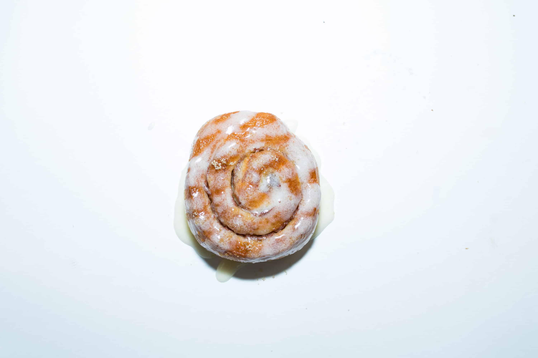 OG cinnamon roll on white background
