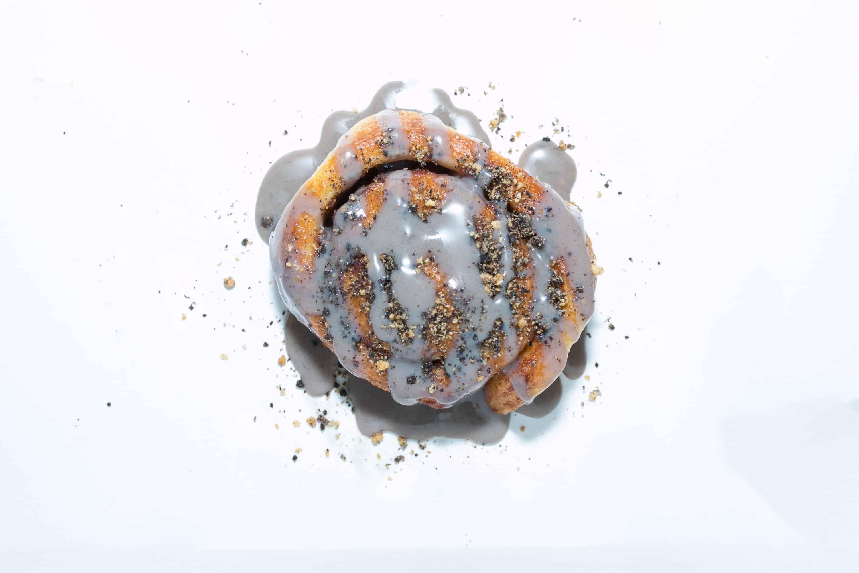 cookie monsta cinnamon roll on white background