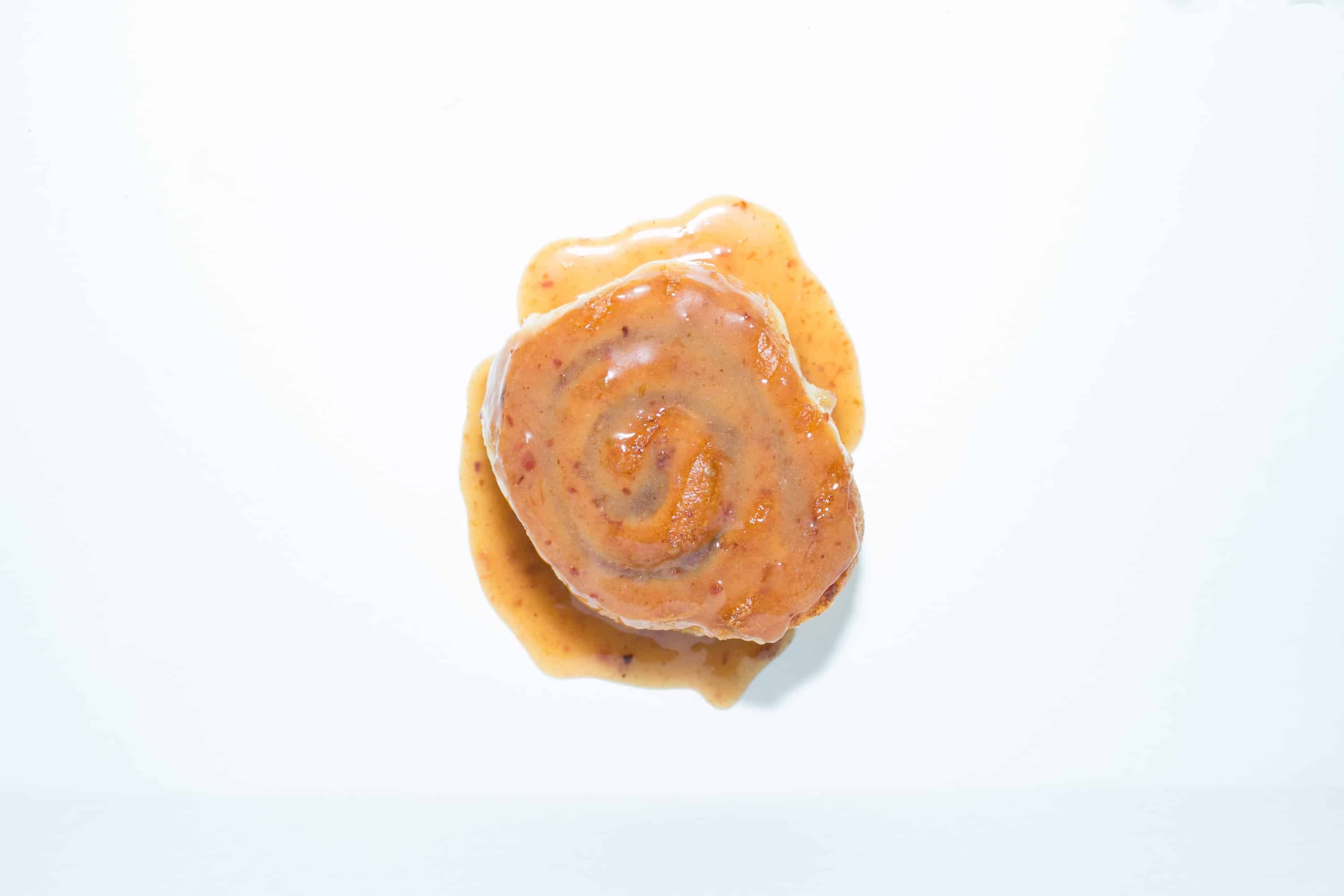 sticky fingaz cinnamon roll on white background