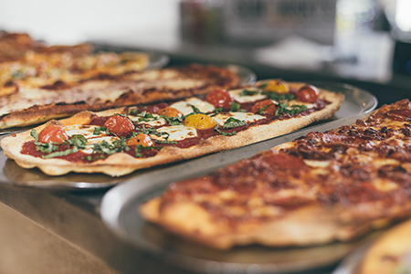 Slim and Husky's Catered Pizza and Cinnamon Rolls